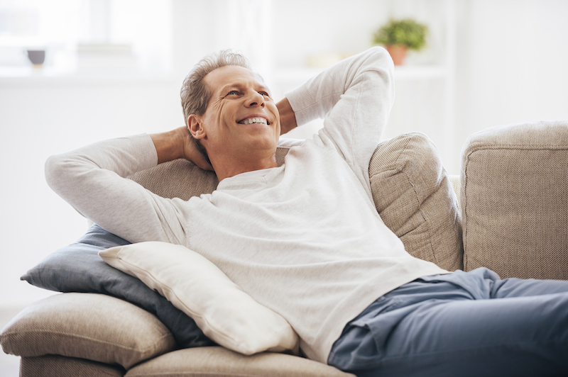man relaxing in air conditioning